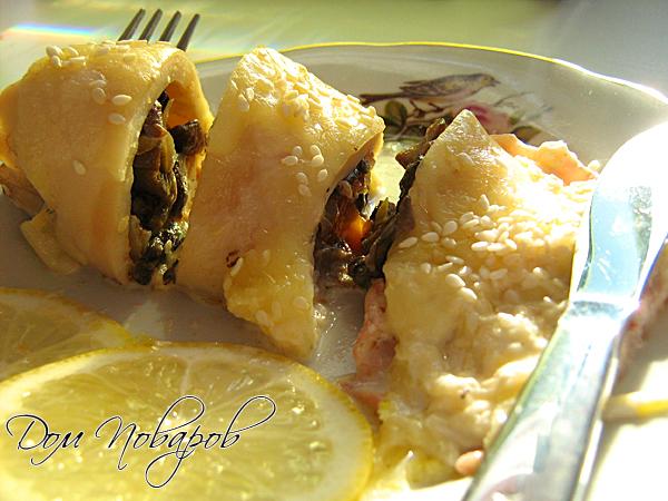 Кальмары фаршированные грибами с сыром, в духовке готовы